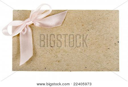 cardboard tags with ribbon bow isolated on white background