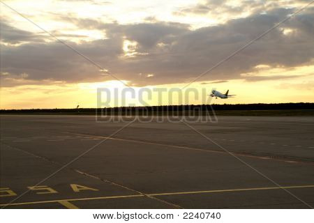 Avión puesta del sol