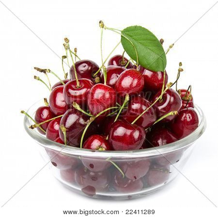 cherries on glass bowl isolated on white background