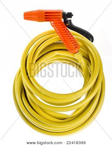 yellow garden hose coiled  with spray nozzle