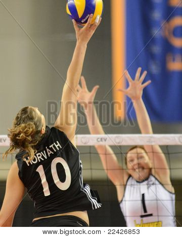DEBRECEN, HUNGARY - JULY 9: Dora Horvath (in black 10) in action a CEV European League woman's volleyball game Hungary (black) vs Israel (white) on July 9, 2011 in Debrecen, Hungary.