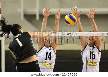 DEBRECEN, HUNGARY - JULY 9: Rita Liliom (in black 1) in action at a CEV European League woman's volleyball game Hungary (black) vs Israel (white) on July 9, 2011 in Debrecen, Hungary.