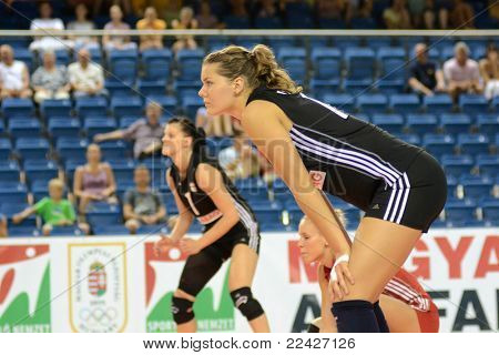 DEBRECEN, HUNGARY - JULY 9: Dora Horvath (R) in action at a CEV European League woman's volleyball game Hungary (black) vs Israel (white) on July 9, 2011 in Debrecen, Hungary.