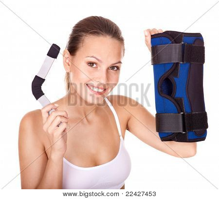 Happy girl holding hinged knee braces. Isolated.
