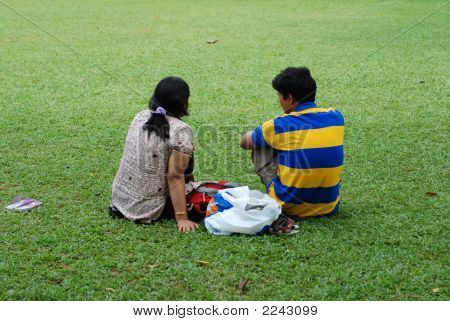 Man And Woman Sitting On The Ground