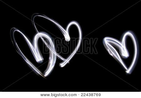 Triplet Of Lightbrushed Hearts Against Black