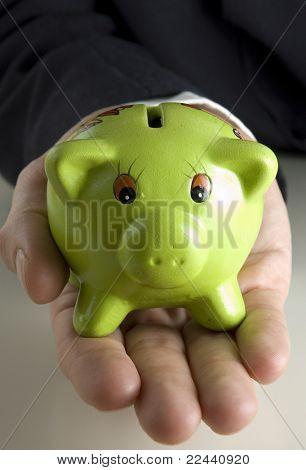 hand holding a piggybank