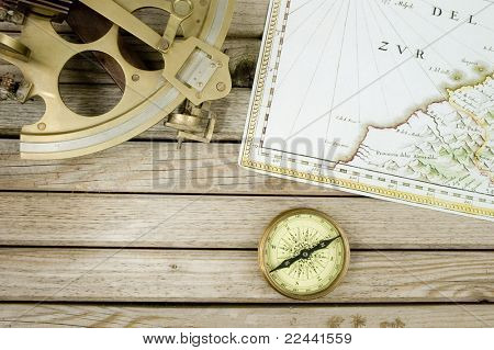 old map (Public domain - 1640 copyright expired) sextant and compass on wood background