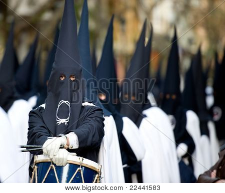 mans with hood. Nazarenes from Semana Santa catholic parade in Spain. Focused on his eyes