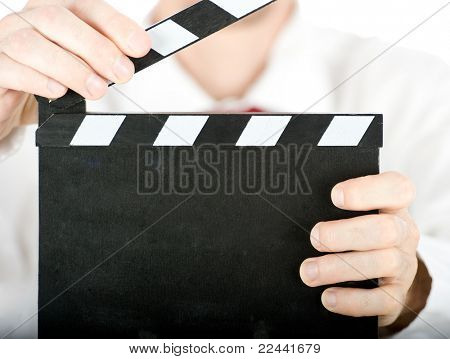 businessman with a clapperboard isolated on white background