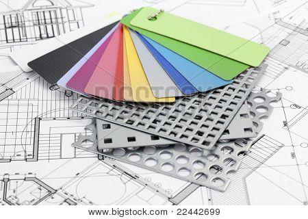 palette of color samples of plastics, PVC, for furnishing, perforated metal, coated with a polymer and architectural plans for houses