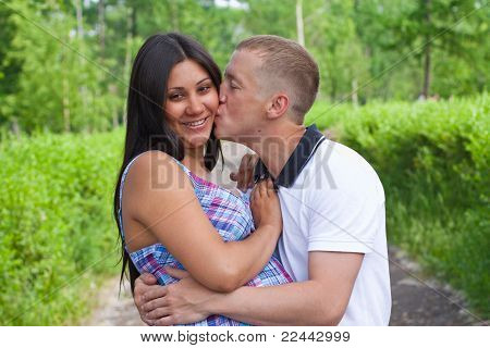 A Pair Of Young Couples Kissing In The Park