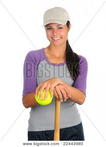 Closeup of a smiling female softball player leaning on a wooden bat and holding a ball. Vertical format isolated on white.