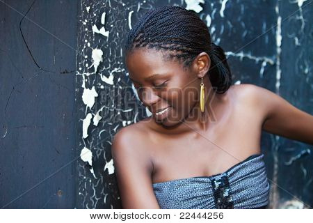 african girl outdoors grungy burned wall and mirror background