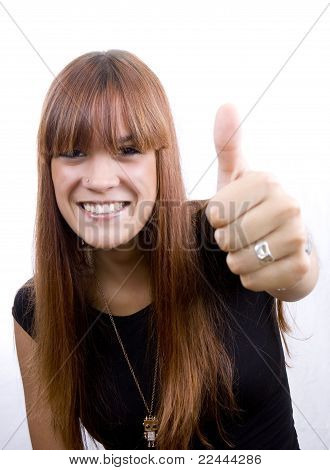 Smiling young girl giving thumbs up