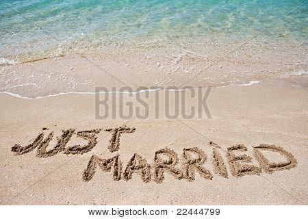 Just married written on the sand