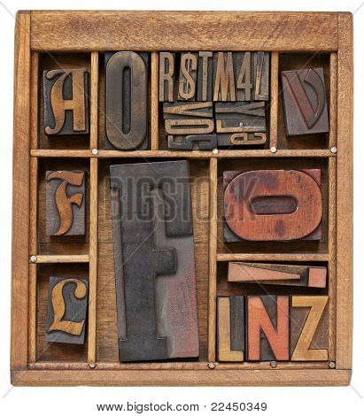 antique letterpress type with letter F