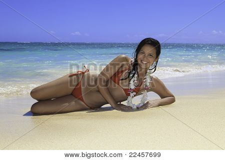 girl lounging on the sand