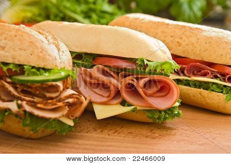 Three different ham and cheese sandwich