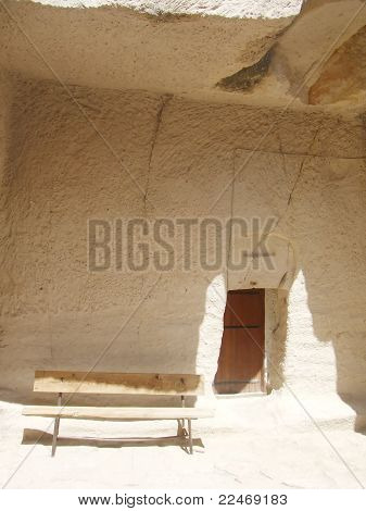 Stone house, wooden chair