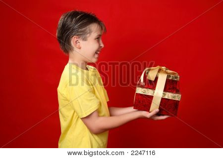 Smiling Boy Giving Christmas Presents