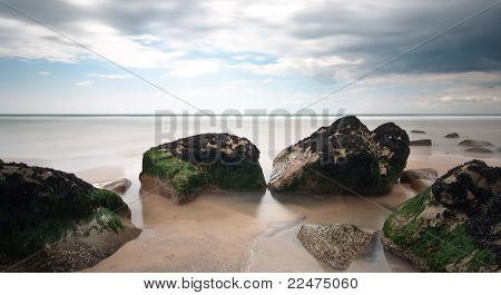 Beach Rocks Long Exposure With Cloudy Sky