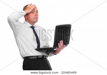 Frustrated businessman with laptop.