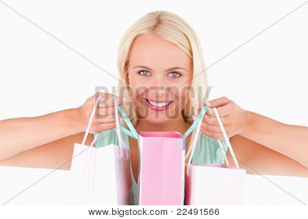 Happy Woman With Bags Looking Into The Camera