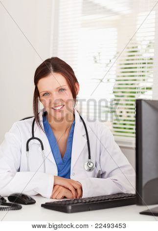 Female Doctor Smiling In Office
