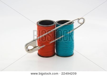 Two Threads Conected By The Safety-pin