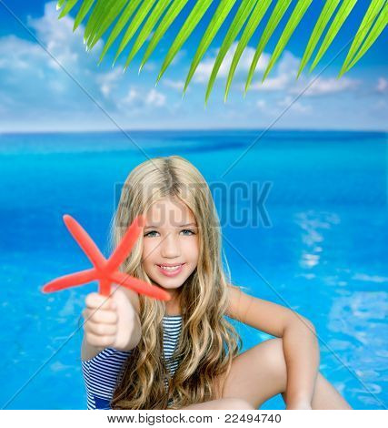 children blond girl in summer vacation tropical beach with starfish  photo illustration