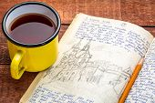 Kayak expedition journal with a cup of hot tea on a rustic picnic table  - handwriting and drawing i poster