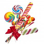 stock photo of lolli  - colorful lollipop with red ribbon bow isolated on white - JPG