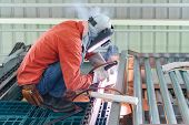 Male Worker Wearing Protective Clothing Welding The Steel Structure,craftsman, Erecting Technical St poster