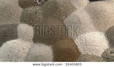 Different Brown Toned Sand Piles To One Another