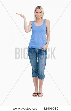Relaxed blonde woman placing her hand palm up against a white background