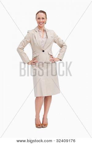 Portrait of a businesswoman with her hands on her hips against white background
