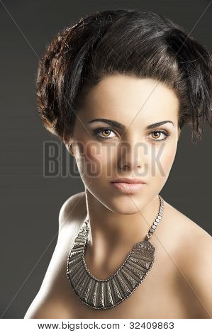 The Girl With Silver Necklace, She Looks In To The Lens