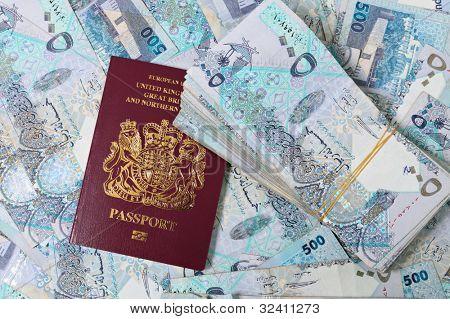 A British passport mixed in with a stash of high-value Qatari banknotes worth about $20,000 - a business opportunity, perhaps.