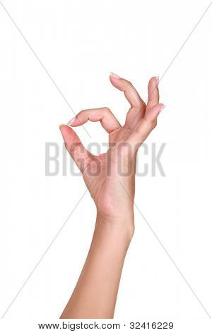 Female hand making an OK gesture