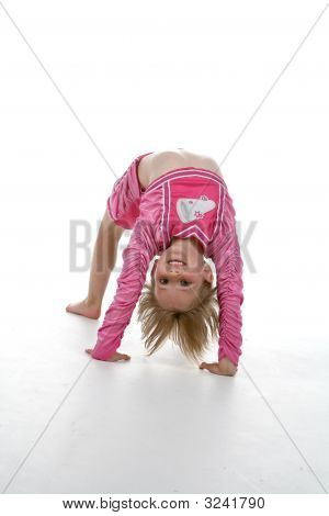 Girl In Cheerleader Outfit Doing Gymnastics Bridge Position
