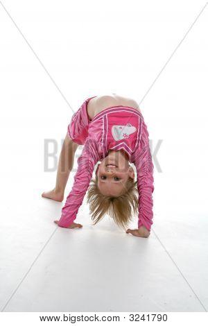 Girl In Cheerleader Outfit Doing Gymnastics Bridge Position