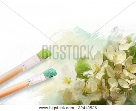 Artist brushes with a half finished painted canvas of flowers