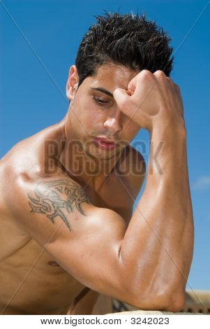 Muscle Body Of A Man Under The Sky