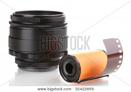 New photo film in cartridge and camera lens isolated on white