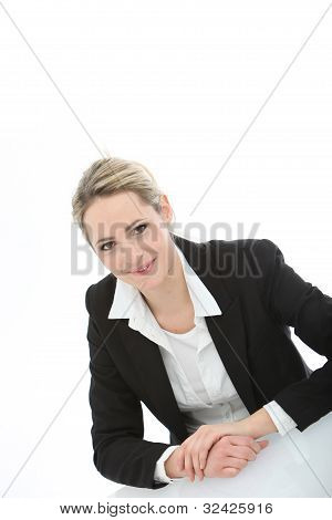 Young Business Woman Sitting At The Table