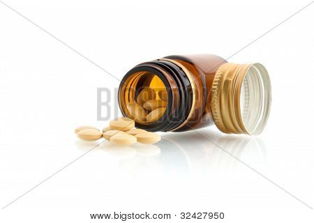 Tablets & Bottle With Lid Isolated On White Background