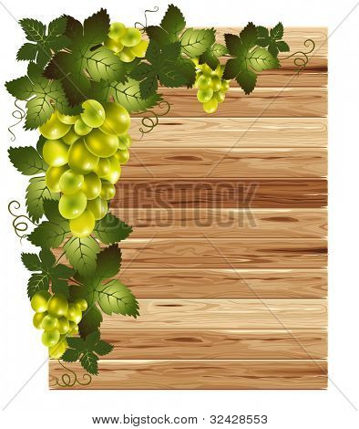 White grapes on a wooden background with space for your text