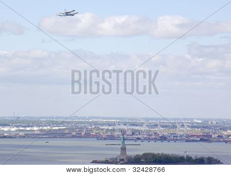 NEW YORK - Oct 8:The space shuttle Enterprise mounted on NASA's 747 Shuttle Carrier Aircraft flies over the Statue of Liberty on October 8, 2011 in New York City. It will be displayed on The Intrepid.