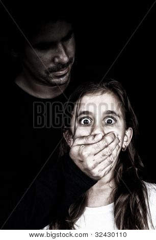 Child abuse and harassment by an adult man with his face in the shadows